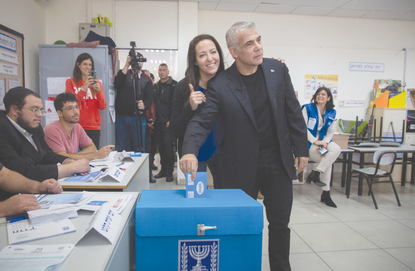 YAIR LAPID casts his ballot at a voting station in Tel Aviv during the Knesset elections on March 2, 2020. (photo credit: MIRIAM ALSTER/FLASH90)