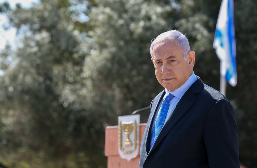Prime Minister Benjamin Netanyahu at a memorial ceremony for Joseph Trumpeldor in Tel-Hai, northern Israel, February 23, 2021 (photo credit: DAVID COHEN/FLASH 90)