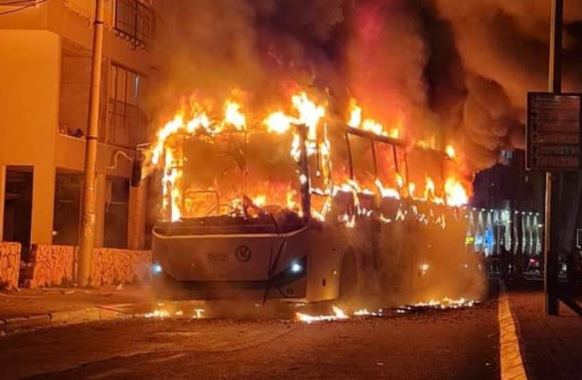 SIMMERING ANGER: The torched bus burns in Bnei Brak in late January. (photo credit: ISRAEL POLICE SPOKESMAN)