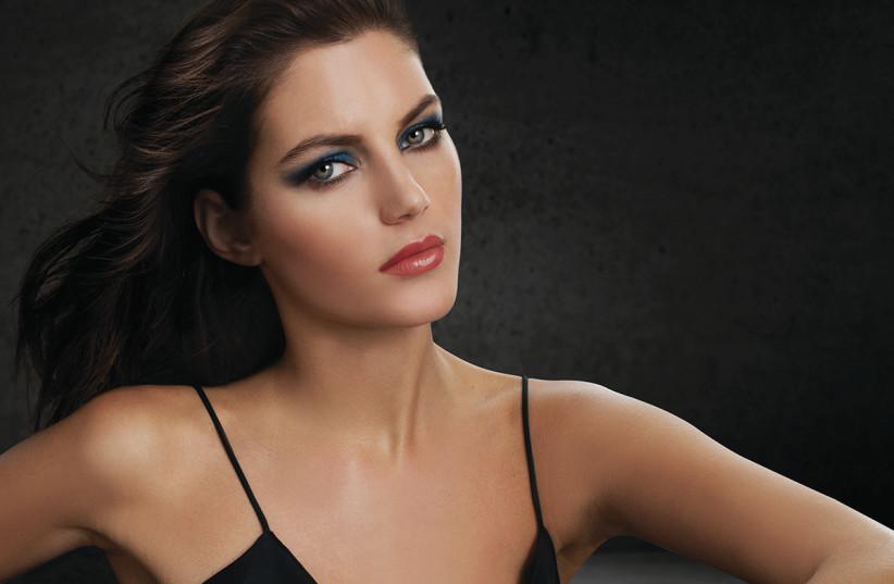A woman is seen wearing Ga-De lipstick. (photo credit: Courtesy)