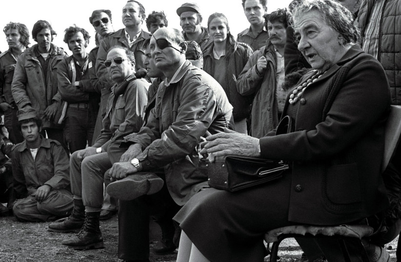 PRIME MINISTER Golda Meir accompanied by Defense Minister Moshe Dayan on the Golan Heights in 1973 after the Yom Kippur War. The author's account is set against Israel's own story of triumphs and disasters connected to the war. (photo credit: REUTERS)