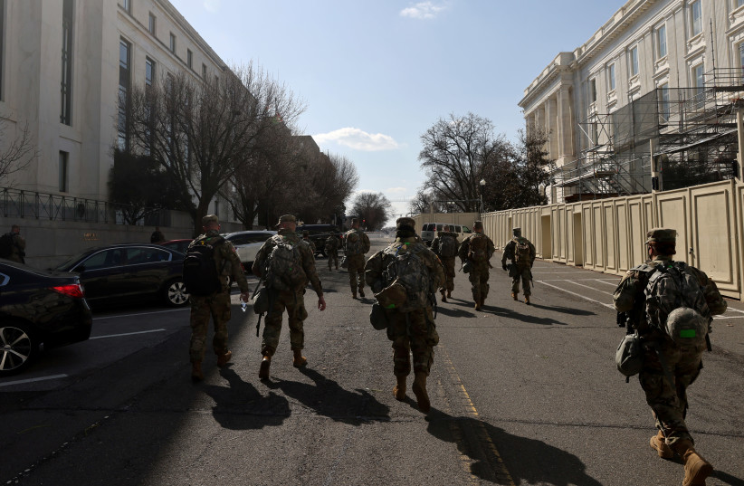 National Guard soldiers patrol the compound around the US Capitol after police warned that a militia group might try to attack the Capitol complex in Washington, US, March 4, 2021. (photo credit: REUTERS/JONATHAN ERNST)