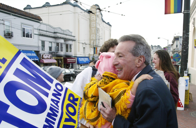 San Francisco Supervisor and mayoral candidate Tom Ammiano hugs supporters before voting in the Castro District of San Francisco on Election Day, November 4, 2003. (photo credit: REUTERS/SUSAN RAGAN SR/GAC)