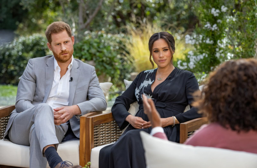 Britain's Prince Harry and Meghan, Duchess of Sussex, are interviewed by Oprah Winfrey in this undated handout photo. (photo credit: HARPO PRODUCTIONS/JOE PUGLIESE/HANDOUT VIA REUTERS)