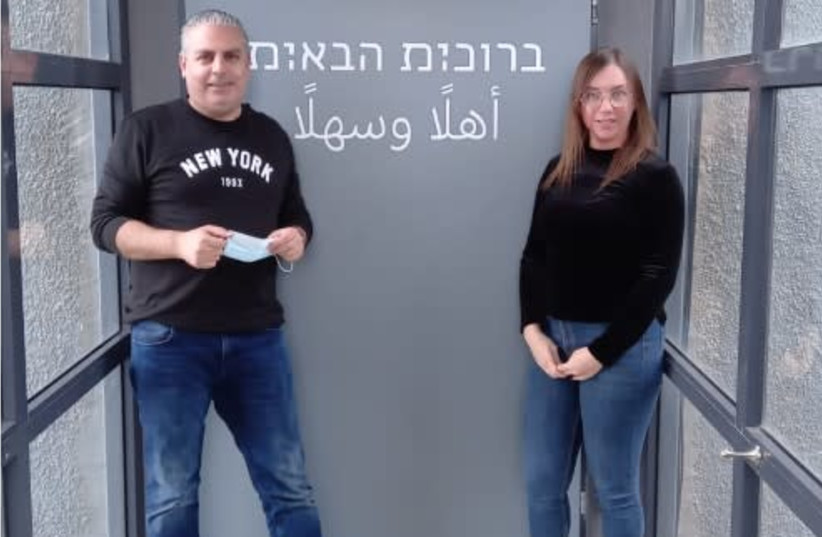 In honor of International Women's Day, Keter has put up signs across its eight facilities that say 'Welcome' to men and women in Hebrew and Arabic. Designed by Michal Shomer.  (photo credit: O-PRODUCTIONS)