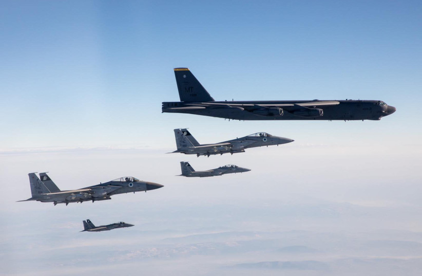 Israeli Air Force F-15 fighter jets escort two American B-52 bombers through Israeli airspace. March 7, 2021. (photo credit: IDF)