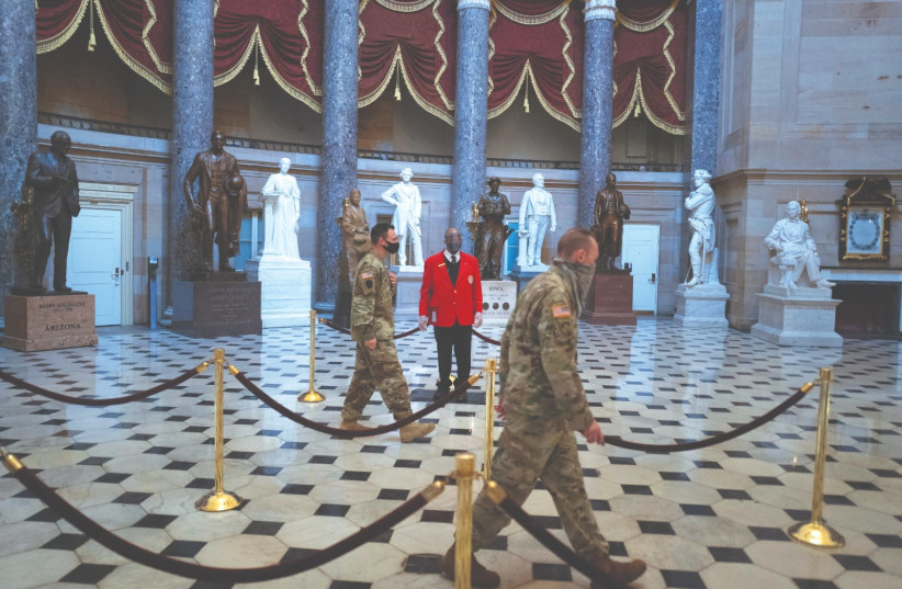 US NATIONAL GUARD soldiers walk through Statuary Hall on Capitol Hill in Washington three weeks after the Capitol riot. Real leaders care about the hearts they hold as they walk people through the inevitable human experience of loss. (photo credit: TOM BRENNER/REUTERS)