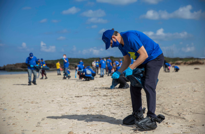 EU Ambassador to Israel Emanuele Giaufret was joined by more than two dozen envoys from EU member states, including 10 ambassadors, at a large-scale beach clean-up operation at the Beit Yanai National Park near Netanya, Friday, March 5, 2021. (photo credit: ELI DASSA)