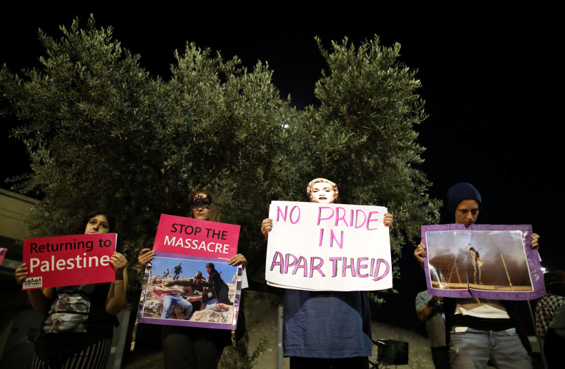 Supporters of the 'BDS' movement protest outside the venue where the 2019 Eurovision song contest final is about to take place in Tel Aviv (photo credit: AMMAR AWAD / REUTERS)