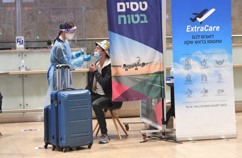 Rapid testing at Ben-Gurion Airport before fight, March 8, 2021.  (photo credit: AVSHALOM SASSONI/ MAARIV)