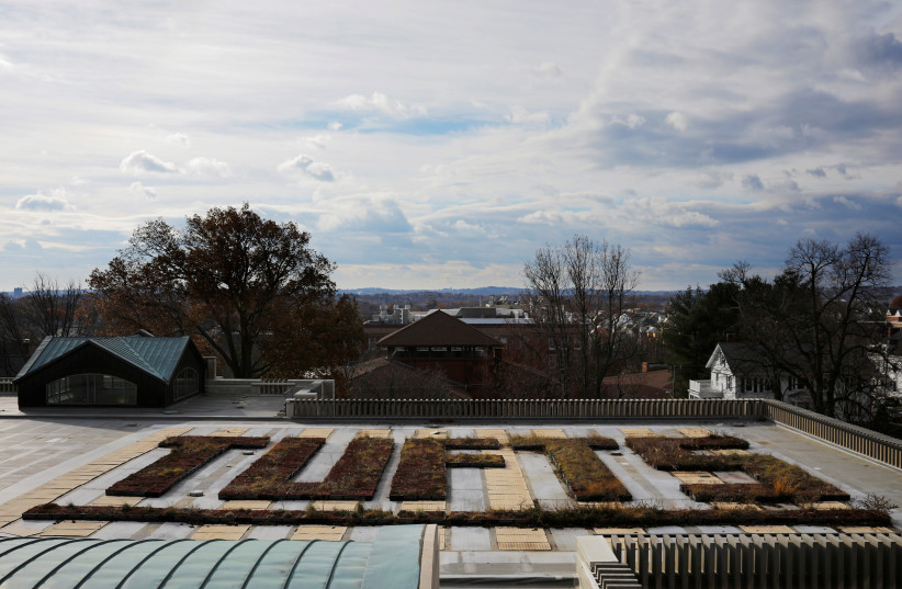 Plants in beds spell out the school's name on the roof of the library at Tufts University in Medford, Massachusetts, US, November 27, 2017.  (photo credit: REUTERS/BRIAN SNYDER)