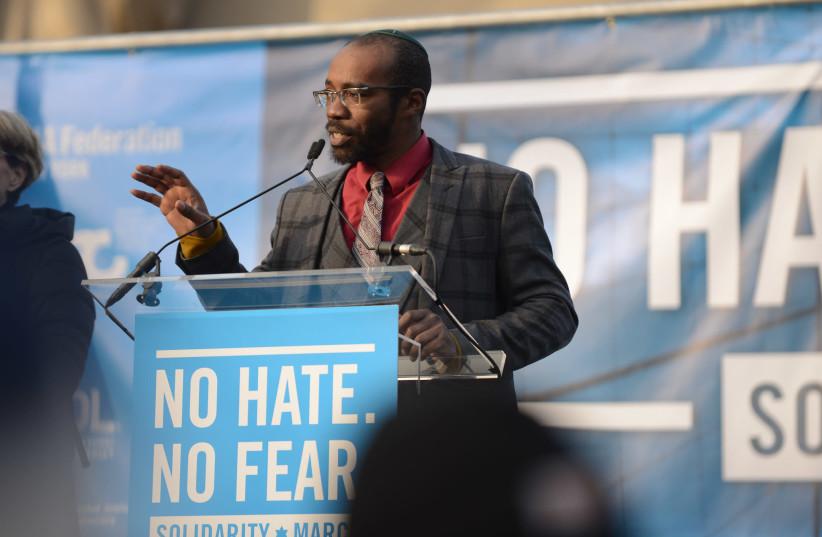 Rabbi Shais Rishon speaks at a rally in New York City, January 2020.  (photo credit: GILI GETZ)