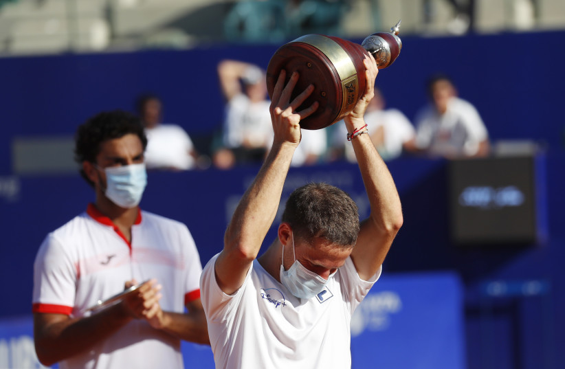 Tennis - ATP 250 - Argentina Open - Buenos Aires Lawn Tennis Club, Buenos Aires, Argentina - March 7, 2021 Argentina's Diego Schwartzman celebrates winning the final against Argentina's Francisco Cerundolo with the trophy. (photo credit: REUTERS/AGUSTIN MARCARIAN)