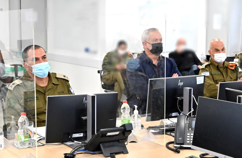 Defense Minister Benny Gantz listening to an IDF briefing on Tuesday March 9 2021 (photo credit: ARIEL HERMONI / DEFENSE MINISTRY)