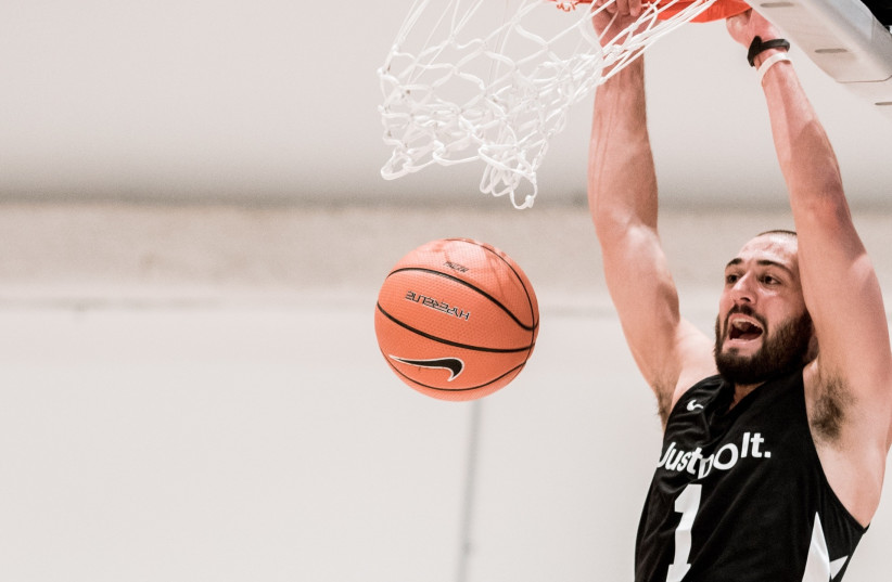 MIKE KAUFMAN definitely get around all over the basketball map  seen dunking at a Nike tournament in New York (photo credit: Courtesy)