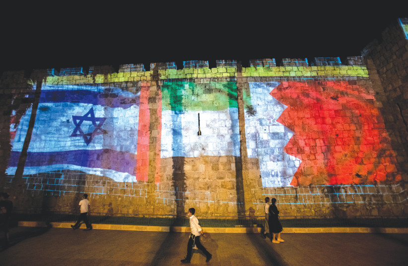 THE FLAGS of the US, UAE, Israel and Bahrain are projected on the walls of Jerusalem's Old City in September. (photo credit: YONATAN SINDEL/FLASH90)