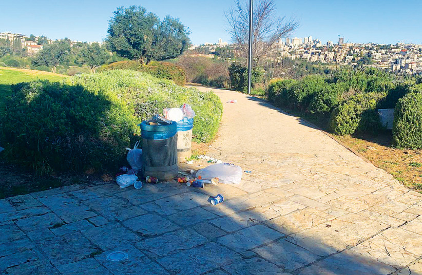 LARGER WASTE receptacles will help eliminate the trash accumulating on the tayelet (photo credit: YAAKOV KATZ)