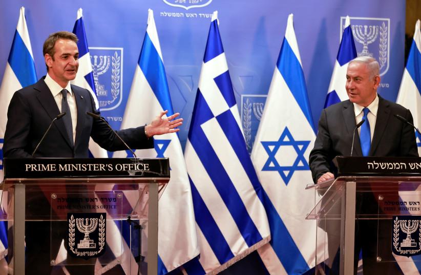 Greek Prime Minister Kyriakos Mitsotakis speaks next to the Israeli Prime Minister Benjamin Netanyahu after their meeting in the PM's office in Jerusalem February 8, 2021. (photo credit: MENAHEM KAHANA/POOL VIA REUTERS)