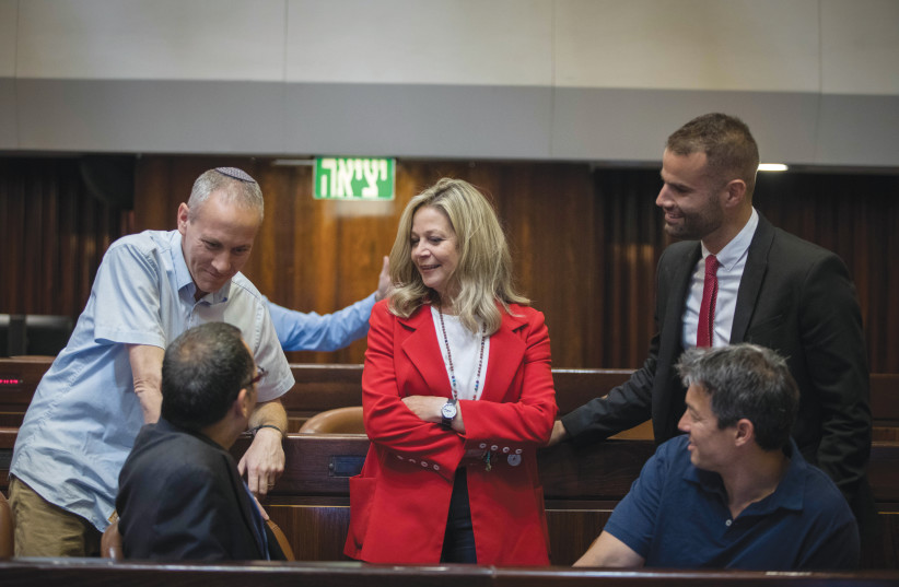 UNITED BLUE and White: Chili Tropper (top left) and Yoaz Hendel (bottom right) talk with fellow incoming MKs (from left: Zvi Hauser, Miki Haimovich, Yorai Lahav Hertzanu) ahead of 21st Knesset opening session, April 2019 (photo credit: NOAM REVKIN FENTON/FLASH90)