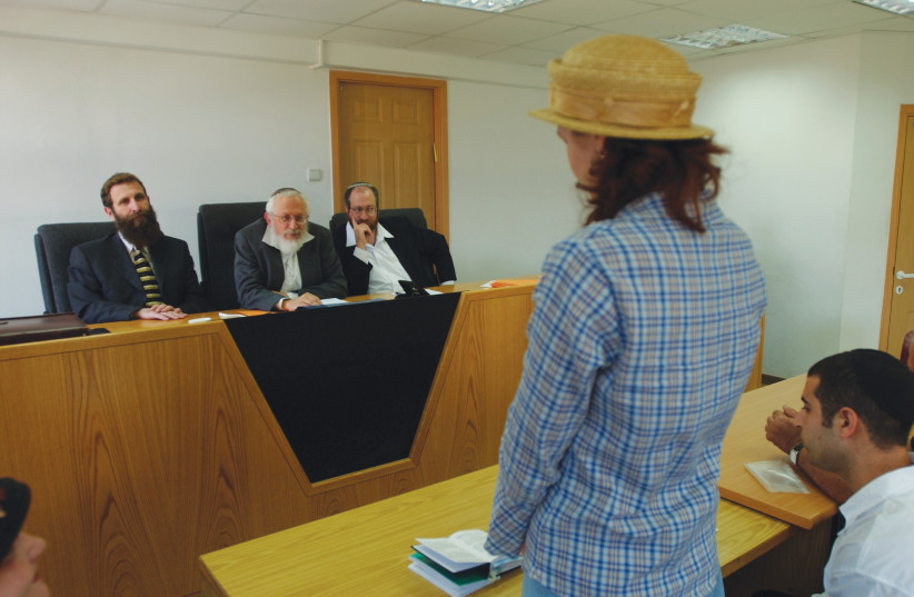 A WOMAN converts to Judaism in the Jerusalem Rabbinic Court (photo credit: FLASH90)
