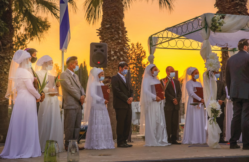 FIVE PAIRS of Bnei Menashe immigrants remarry in a traditional Jewish wedding ceremony last week.  (Laura Ben-David/Shavei Israel) (photo credit: LAURA BEN-DAVID/SHAVEI ISRAEL)