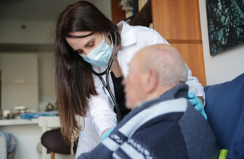 A Holocaust survivor receives free treatment from a doctor (photo credit: DANIEL BAR ON)