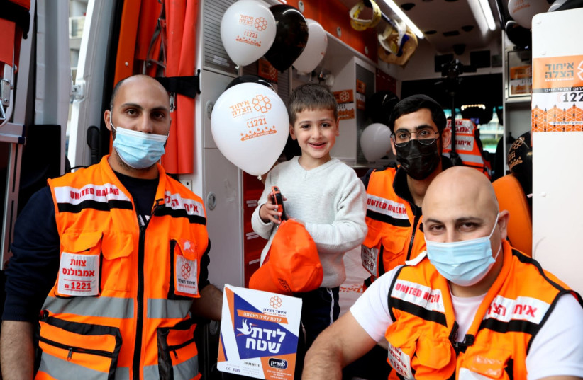United Hatzalah volunteers celebrate birthday of twins they helped deliver. (photo credit: HATZALAH UNITED)