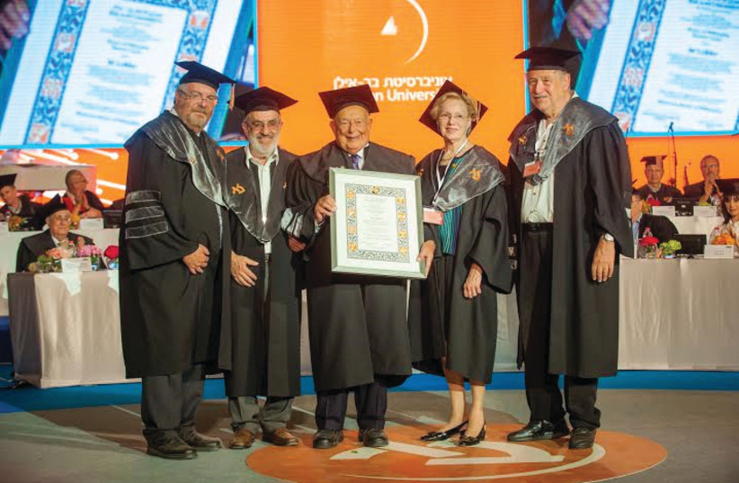 ISI LEIBLER receives his honorary doctorate at Bar-Ilan University with his wife, Naomi, and BIU faculty members. (photo credit: COURTESY BIU)
