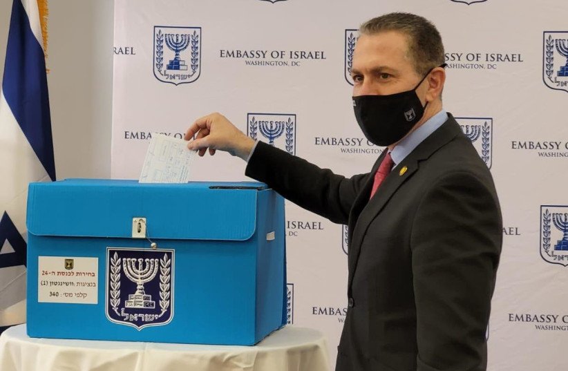 Israel's Ambassador to the US Gilad Erdan voting in the US  (photo credit: Courtesy)