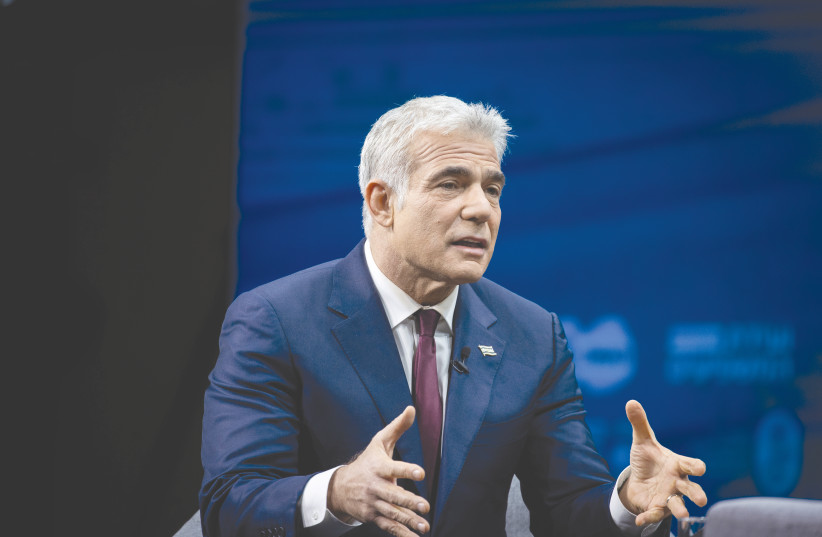 YESH ATID PARTY leader Yair Lapid attends a conference in Jerusalem on Sunday. (photo credit: YONATAN SINDEL/FLASH90)