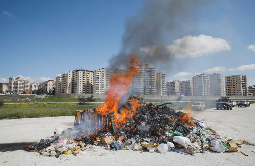THE JERUSALEM MUNICIPALITY burns a pile of hametz collected from across the city, last year. (photo credit: RONEN ZVULUN/REUTERS)