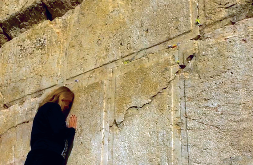 PRAYING AT the Western Wall – five years after first being approved, the Kotel Agreement remains suspended but not forgotten. (photo credit: Courtesy)