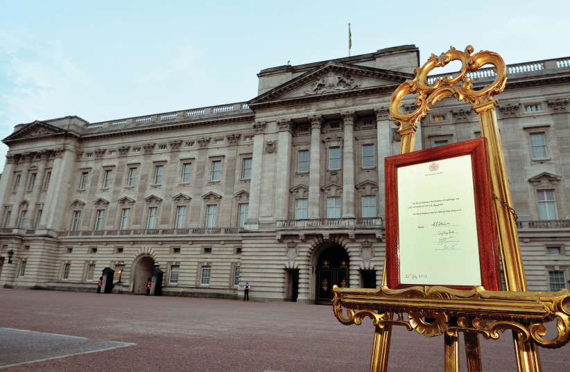 A NOTICE formally announces the birth of a son to Britain's Prince William and Catherine, Duchess of Cambridge, in the forecourt of Buckingham Palace, in July 2013. (photo credit: NEIL HALL/REUTERS)