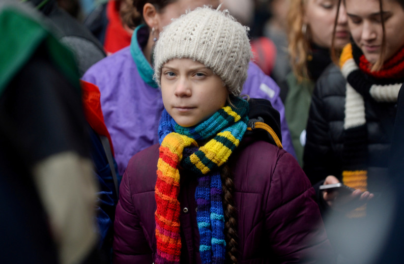 Swedish climate activist Greta Thunberg takes part in the rally ''Europe Climate Strike'' in Brussels, Belgium, March 6, 2020.  (photo credit: REUTERS/JOHANNA GERON/FILE PHOTO)