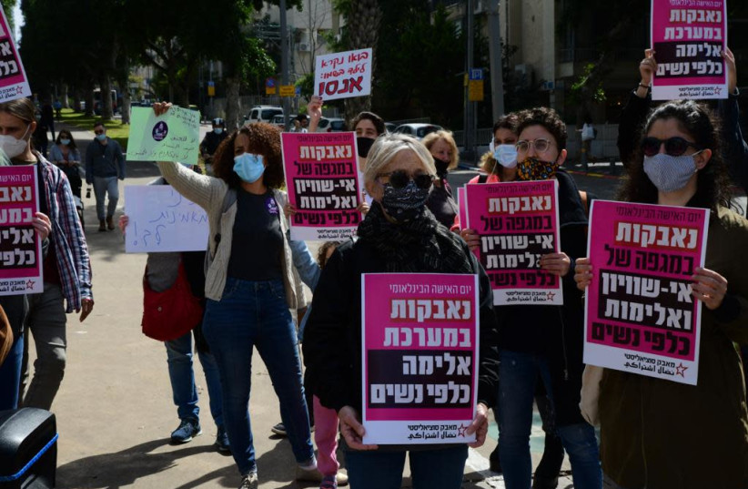 "Protesters hold signs opposing a ""system of violence against women"" (photo credit: AVSHALOM SASSONI)"