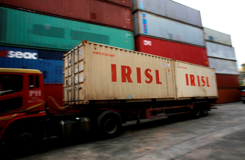A truck carrying Islamic Republic of Iran Shipping Lines (IRISL) containers arrives a depot in northern Singapore (photo credit: THOMAS WHITE / REUTERS)