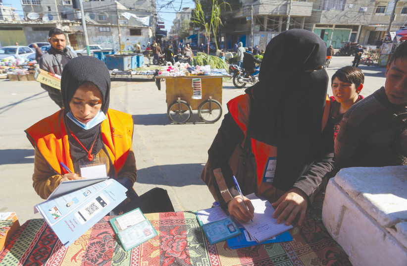 PALESTINIAN CENTRAL Election Commission workers register citizens in preparation for May elections, in Rafah, in the southern Gaza Strip, in February. (photo credit: ABED RAHIM KHATIB/FLASH90)