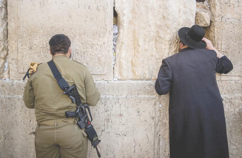 MEN PRAY last year at the Western Wall.  (photo credit: YONATAN SINDEL/FLASH 90)