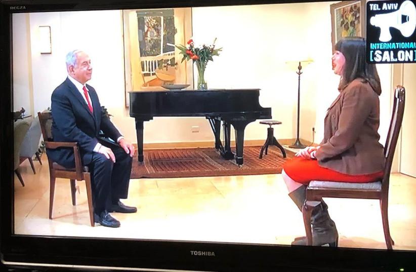 Lahav Harkov with Prime Minister Benjamin Netanyahu (photo credit: screenshot)