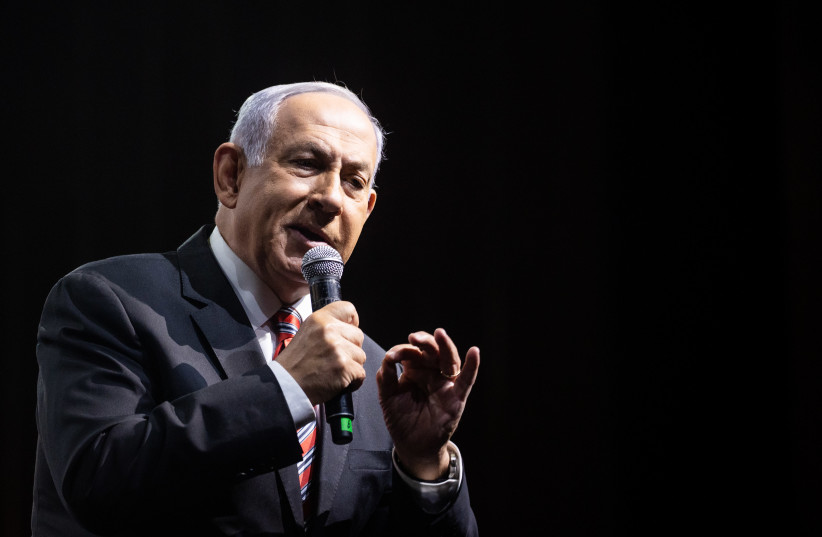 Israeli Prime Minister Benjamin Netanyahu speaks at the annual Jerusalem Conference of the 'Besheva' group in Jerusalem, March 14, 2021 (photo credit: YONATAN SINDEL/FLASH 90)