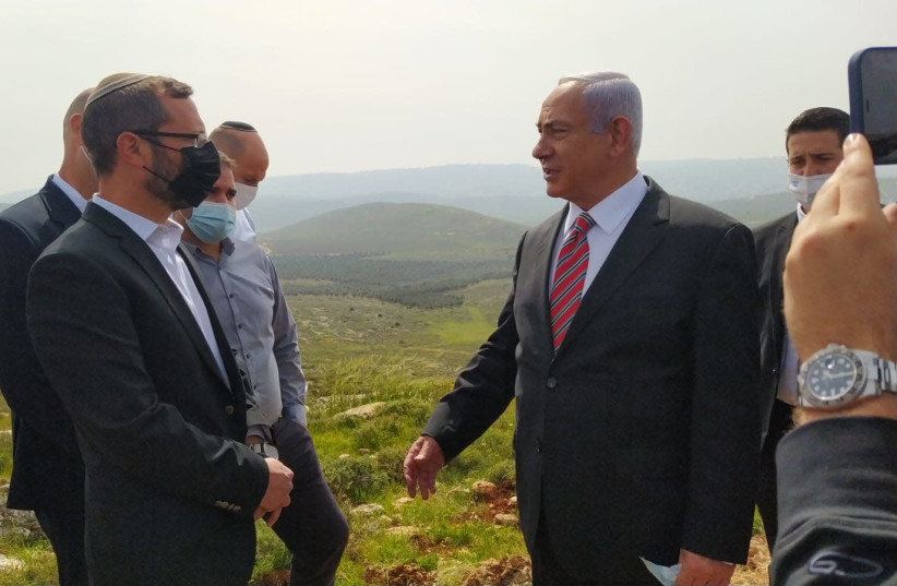 Prime Minister Benjamin Netanyahu during a visit to the Givat Harel outpost in Binyamin region of the West Bank, March 14, 2021 (photo credit: YEHOSHUA MENASHE)