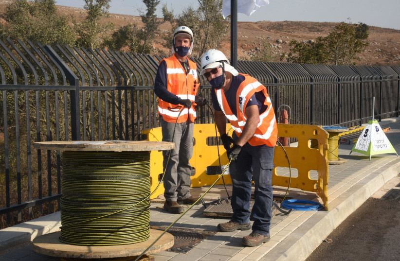 Bezeq workers lay fiber optics lines in Metulla. (photo credit: Courtesy)