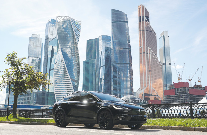 A TESLA Model X electric vehicle is shown in this picture illustration taken in Moscow last year. (photo credit: EVGENIA NOVOZHENINA/REUTERS)