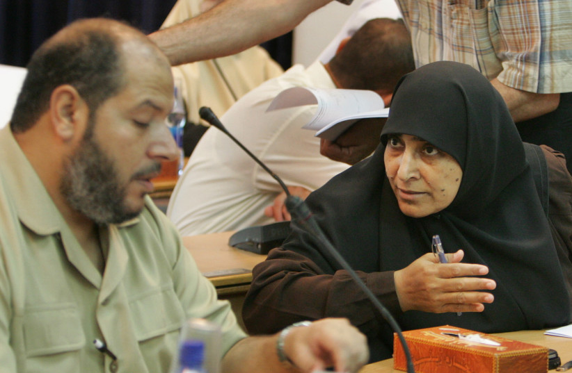 Palestinian lawmaker Jamilah al-Shanti (R) of Hamas attends a parliament session in Gaza July 22, 2007. The parliament session for a vote of confidence was cancelled because Fatah lawmakers did not attend. (photo credit: MOHAMMED SALEM/ REUTERS)