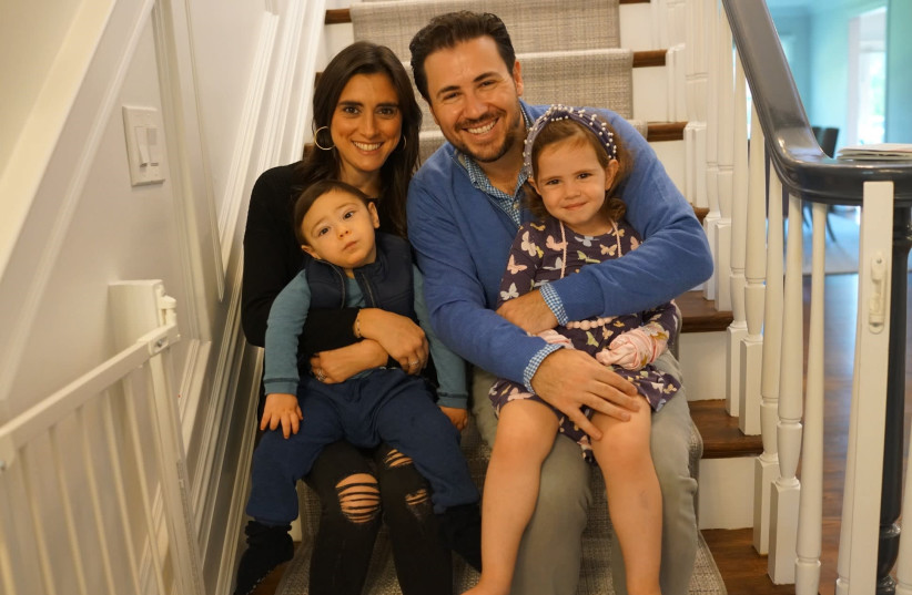 Two-year-old Eli Reich is seen with his family, including father Scott and mother Ilissa. (photo credit: COURTESY THE REICH FAMILY)