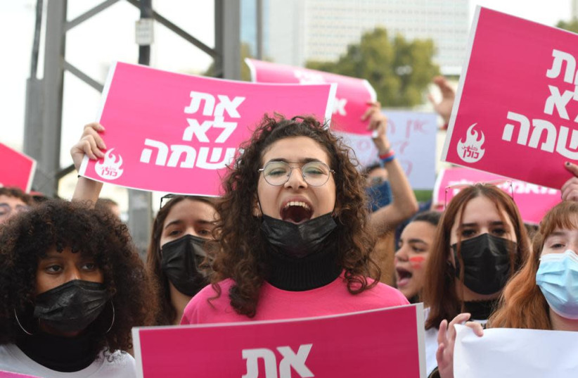 """""""You are not guilty,"""" read signs at the protest against the recent violence against women, March 15, 2021.  (photo credit: AVSHALOM SASSONI/ MAARIV)"""