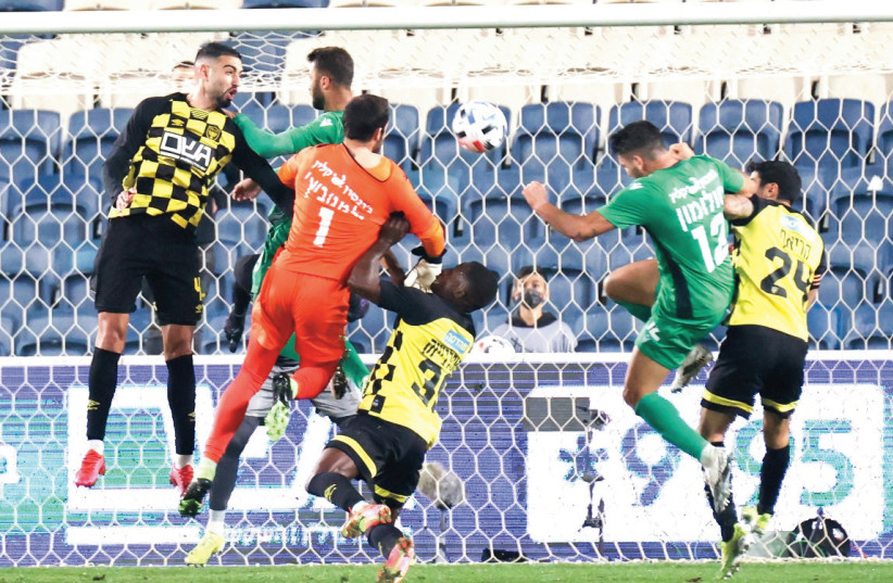 BEITAR JERUSALEM (in yellow) and Hapoel Kfar Saba played an entertaining match on Sunday night at Teddy Stadium, with hosts earning a dramatic 2-1 victory to remain in contention for a championship playoff berth. (photo credit: DANNY MARON)
