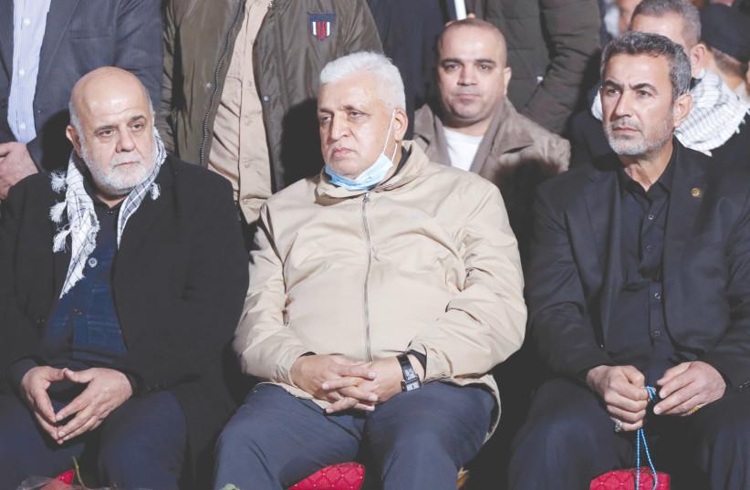 RAQI MILITIA head Faleh al-Fayyad, Deputy Commander Abdul Azizi Al-Mohammedawi, and Iranian Ambassador Iraj Masjedi mark the first anniversary of the killing of Qassem Soleimani and Abu Mahdi al-Muhandis, in Baghdad, Iraq, in January. (photo credit: THAIER AL-SUDANI/REUTERS)