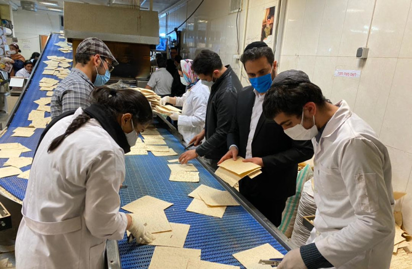 Jews in Tehran producing matza this week ahead of the Passover holiday. (photo credit: THE ALLIANCE OF RABBIS IN ISLAMIC STATES)