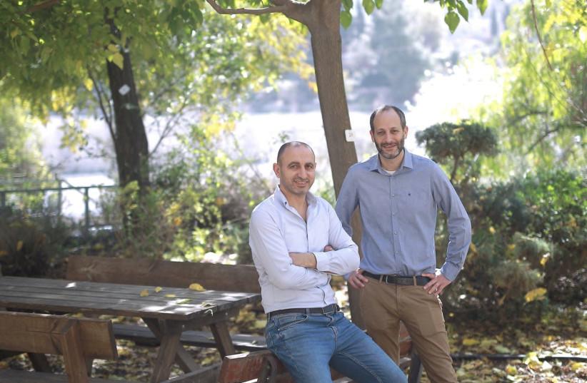 Teramount cofounders Hesham Taha and Avi Israel. (photo credit: ILAN ASSAYAG)
